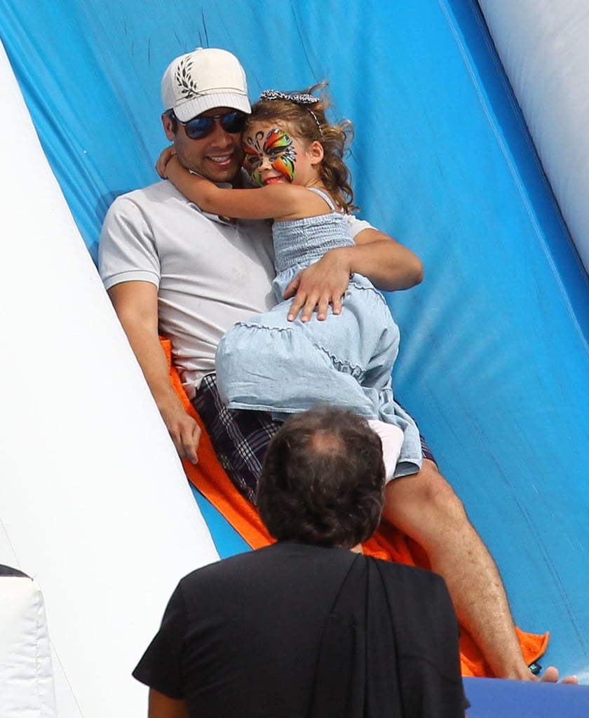 Cash Warren rode a slide at an LA patch with daughter Honor.