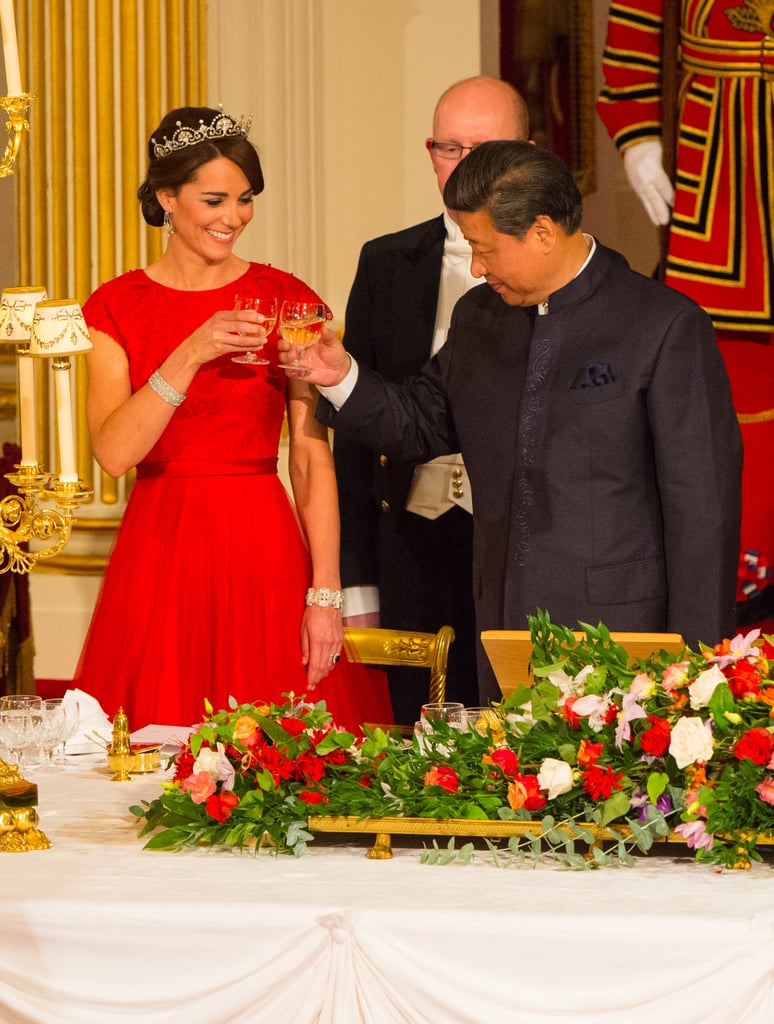 "The Duke and Duchess of Cambridge arrived at Buckingham Palace on Tuesday to attend a state banquet in honor of China's President Xi Jinping. Kate Middleton went glamorous for the event in a red gown and a stunning tiara, though the pin representing The Royal Family Order of Queen Elizabeth ll honor that many had speculated Kate received in September was noticeably absent. The royal couple joined Queen Elizabeth II and Prince Philip, Duke of Edinburgh, in welcoming the Chinese president and his wife, Madame Peng Liyuan, who are set to spend four days in the UK as the queen's guests.  There were 130 guests at the state dinner, and the night kicked off with a speech from the queen, who has hosted 110 state visits throughout her reign and who called the state visit ""a defining moment in this very special year for our bilateral relationship."" Keep reading for more pictures from the special event, then check out the year's best pictures of the British royals!"