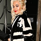 Rita Ora added some serious drama to her vintage waves with a gilded hair accessory.