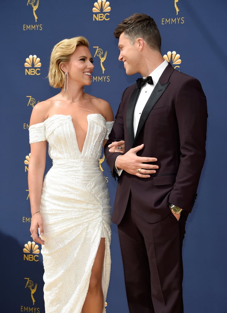It's only been four months since Scarlett Johansson and Colin Jost made their red carpet debut as a couple, but there's no denying that these two are naturals. On Monday night, Scarlett and Colin posed together at the 2018 Emmys on Monday night, where they were all smiles before his hosting duties kick off. Colin and his Saturday Night Live costar Michael Che are hosting the highly anticipated show, but before they bring on the jokes, Colin posed with his life costar for a whole lot of loved-up photos. The two have been quietly dating since May of last year, and although their public appearances are rare, we are living for their big Emmys night out. Read on to see Scarlett and Colin's adorable photos.      Related:                                                                                                           Announcing the 2018 Emmy Nominees!