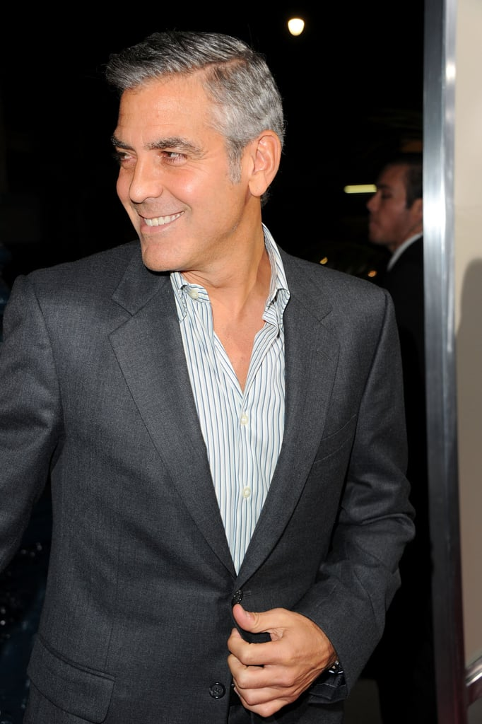 George Clooney smiled on the red carpet.
