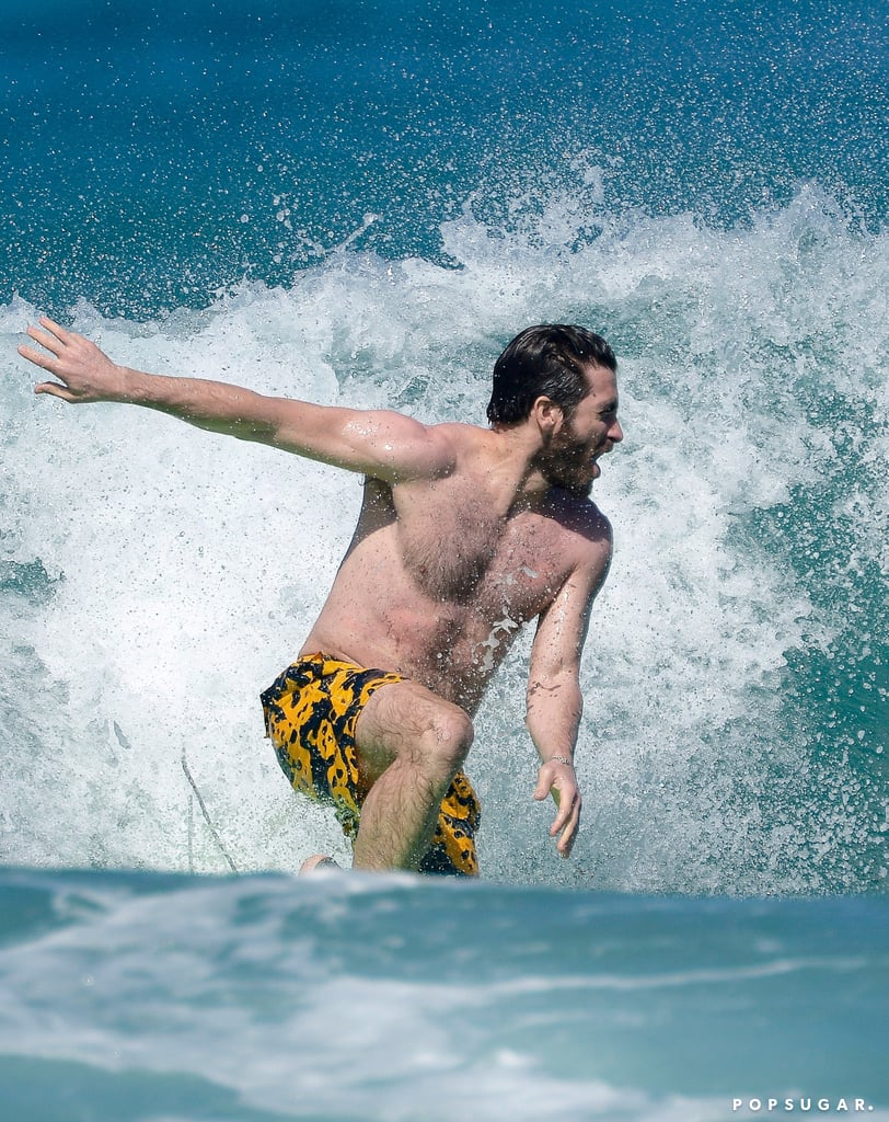 """Jake Gyllenhaal is having a blast in St. Barts. After hitting the beach with longtime friend Greta Caruso earlier in the week, the actor was spotted in the water for an impressive surf session on Thursday. Shirtless and clad in printed trunks, Jake looked supersexy as he caught a few waves. After the fun, Jake and Greta were all smiles while chatting on the beach. Isn't there something oddly fascinating about these photos?      Related:                                                                                                           44 Pictures of Jake That Will Have You Saying """"Gyllenhaal-elujah!"""""""