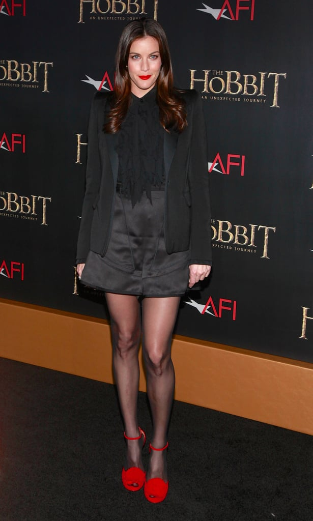 At The Hobbit premiere in NYC, Liv Tyler started off with an all-black ensemble, then added major pizzazz, thanks to her red ankle-strap sandals and red lips. You should do the same on your hot date.