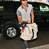 Zac Efron Sports a Scruffy Mustache on His Way to Cannes