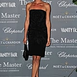 Romanian model Catrinel Marlon dressed up a simple strapless LBD with sweet bow-tie T-strap sandals.