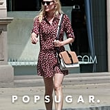 Diane Kruger created a fashionable pairing when she wore a red animal-print romper with a Tila March colorblock bag.