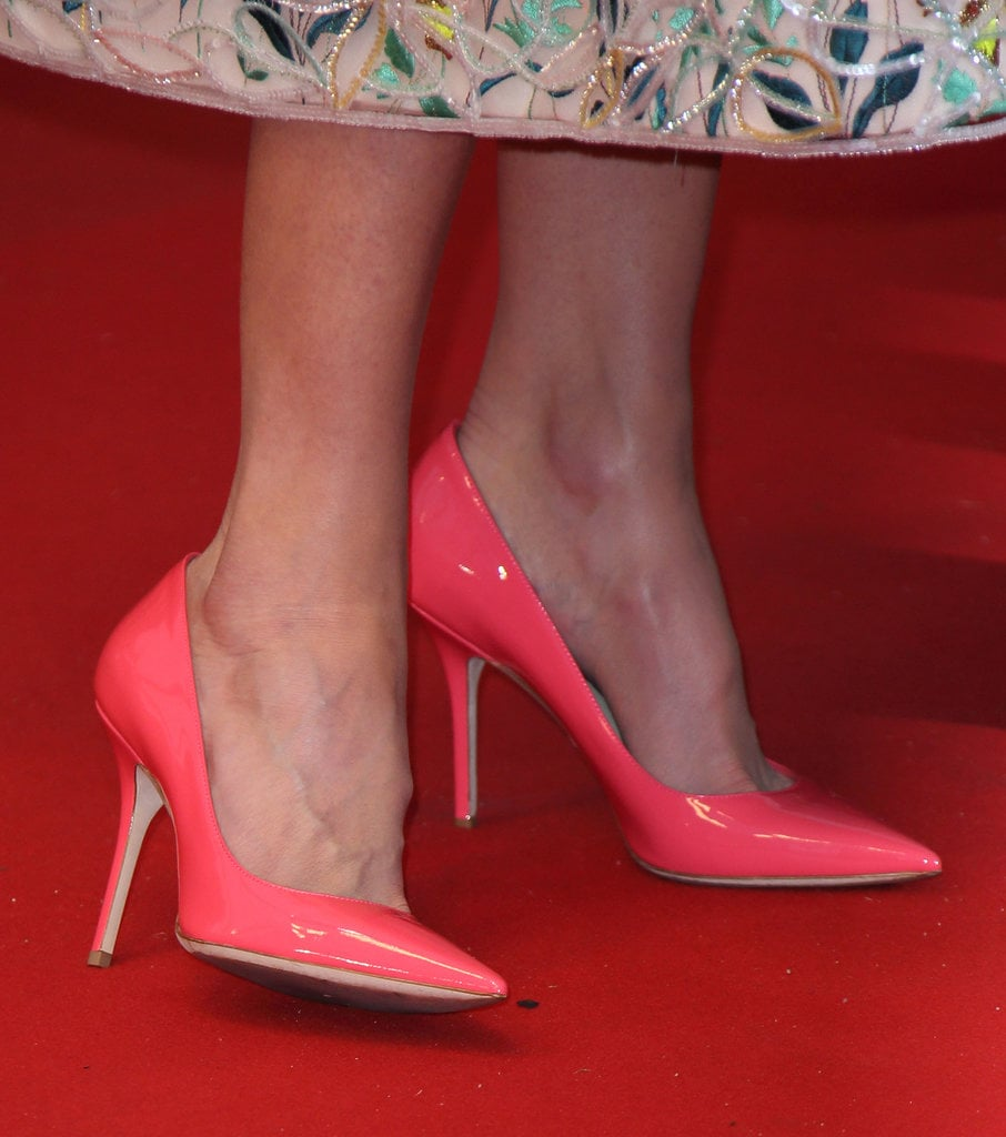 Nicole Kidman wore bright coral Jimmy Choo pumps.