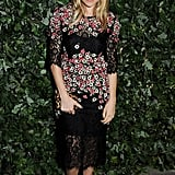 We loved seeing Sienna Miller in a moody floral Dolce & Gabbana dress and classic pumps at a Global Fund affair in London.
