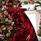 Kris had smaller Christmas trees behind her main one in her foyer in 2016.
