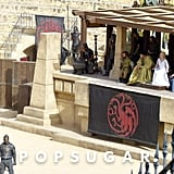 The sigil of House Targaryen announces Daenerys's presence.