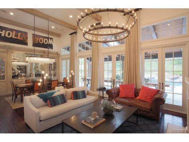 Cathedral vaulted ceilings soar to 9 feet high in the for Living room with 9 foot ceilings