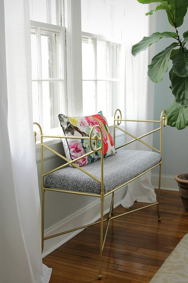 This gold bench is reminiscent of Cinderella's pumpkin carriage — she'd definitely include it in her modern-day castle.