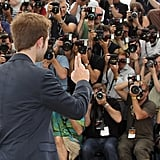 Robert Pattinson turned to photographers at the Cosmopolis photocall in Cannes.