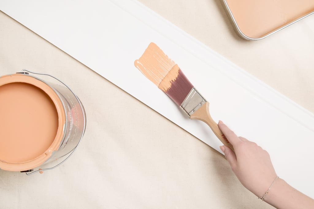 Try a pop of light orange on your baseboards
