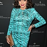 Joan Collins wore a patterned dress.