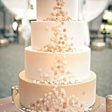 Count this as the most elegant confetti we've ever seen. The fun details on this four-layered, blush-colored wedding cake are pretty exceptional.