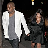 Kim Kardashian and Kanye West held hands.