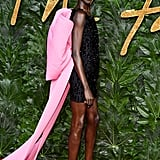 For an appearance at the British Fashion Awards, Alek wore a sparkling minidress that featured the biggest, longest pink bow.