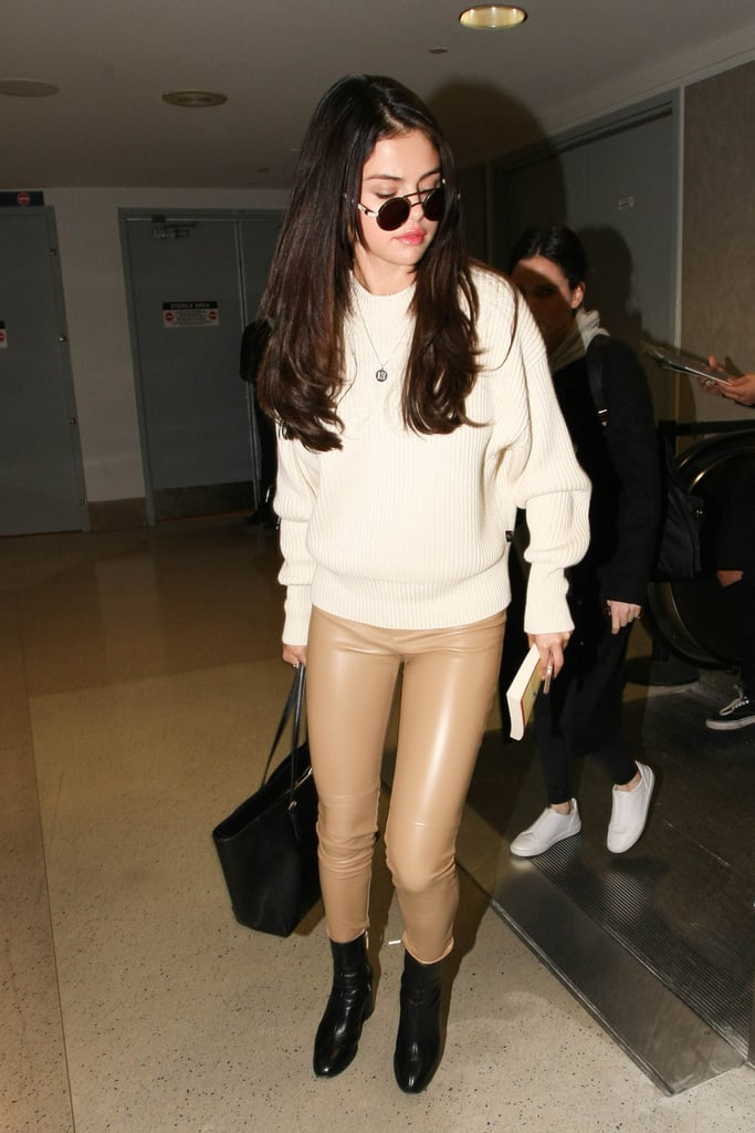 Fall staple: a Ribbed mockneck sweater by Victor Glemaud. Selena wore it with: Wolford leather leggings, black boots, and a black bag at LAX in November 2016.