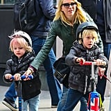 Naomi Watts whizzed through NYC with her boys on Sunday.