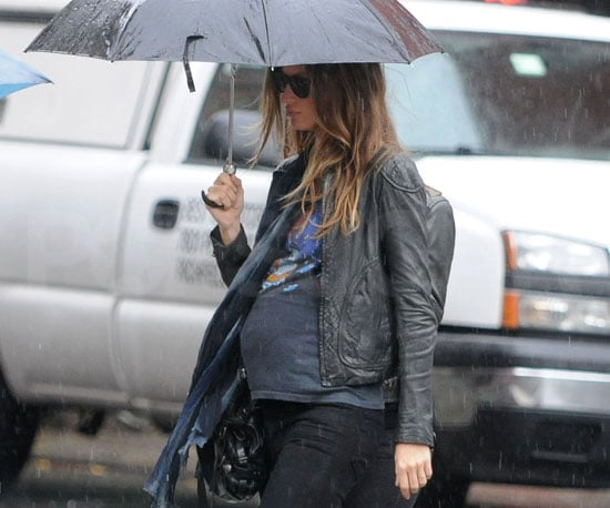 Slide Photo of Gisele Bundchen Out in Rainy NYC Showing Off Baby Bump