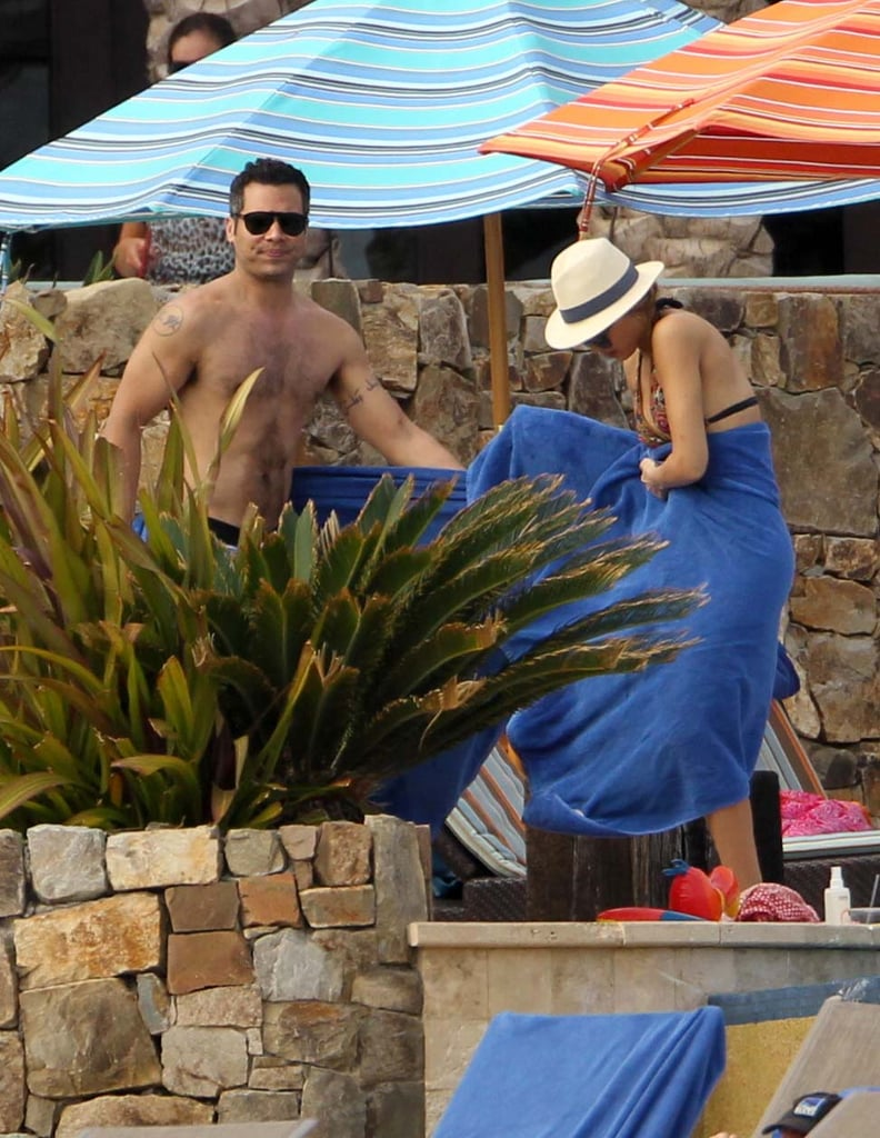 Jessica Alba and Cash Warren enjoyed a dip in a pool.
