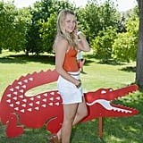 Teresa Palmer stopped for a photo op near a Lacoste prop.