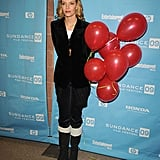 Uma Thurman dressed up shearling-lined boots with a velvet blazer in '09.