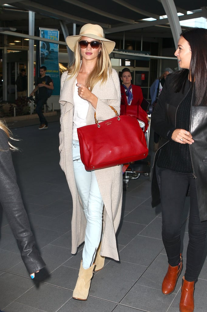 Toting a big, bright red designer handbag and dressed in shades of cream, model Rosie Huntington-Whiteley didn't slip under the radar when she landed at Sydney Airport this morning. The Victoria's Secret Angel is here for beauty brand Model Co after being announced as their new ambassador two months ago. She's expected to go straight to Hayman Island, where she'll shoot the new Summer 2013 campaign and be the guest of honour at an exclusive dinner that will also be attended by fellow Model Co ambassador Dannii Minogue. The British beauty also made headlines last week thanks to a cute new Glamour US magazine cover, which she fronts with the cheeky boys of One Direction. The last time Rosie visited Australia was in May 2012, when she snuck into the country for a quick personal trip.