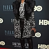 Angela Bassett went for a bold patterned coat.