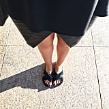 Want to take an all-black ensemble to a more interesting level? Mix it with three different types of textures: silk, leather and hairy slides!