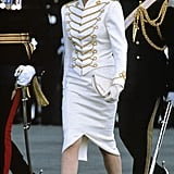 In 1987, Diana channeled military chic in a white and gold two-piece by her favorite designer Catherine Walker.