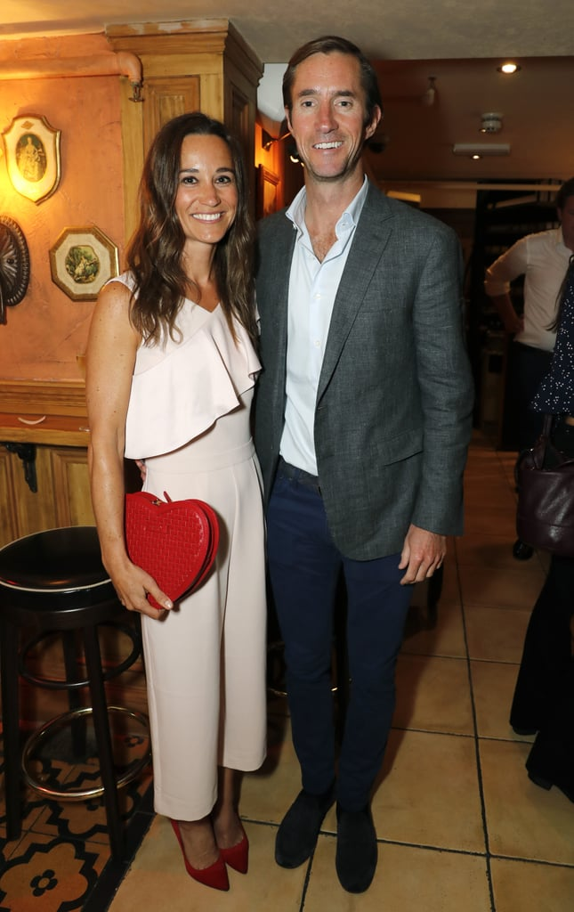 Pippa Middleton has that newlywed glow! On Wednesday, she and her husband, James Matthews, were all smiles when they attended The Miles Frost Fund Party in London. Pippa stunned in a pale pink jumpsuit complete with a heart-shaped clutch while James sported a gray sport coat and blue trousers. The couple mingled with guests at the star-studded event, which also brought out Princess Eugenie, Duchess of York Sarah Ferguson, Lady Carina Fitzalan-Howard, and David Furnish. The charity event was held as a fundraiser for hypertrophic cardiomyopathy research (a heart condition which Sir David Frost's son Miles died from in 2013) and doubled as Pippa and James's first public appearance since tying the knot in May.   After their idyllic, fairy-tale wedding in the UK, Pippa and James jetted off to French Polynesia for their honeymoon. While there, Pippa put her toned physique on display in a bright blue bikini as she and James did some paddleboarding together. They also visited Australia and were seen boarding a seaplane in Sydney Harbor. We must say, marriage sure looks good on these two.