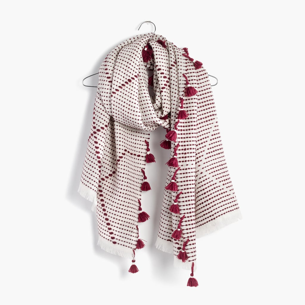 The perfect scarf should be two things: cozy and cuddle-worthy. This Madewell scarf ($65) meets both requirements.