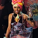 Nicki Minaj took the stage in a colorful ensemble to pick up her award for best pop video.