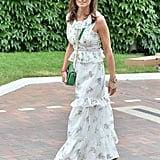 Wearing a Weekend Max Mara dress with a green Tory Burch bag and L.K. Bennett wedges at Wimbledon in 2017.