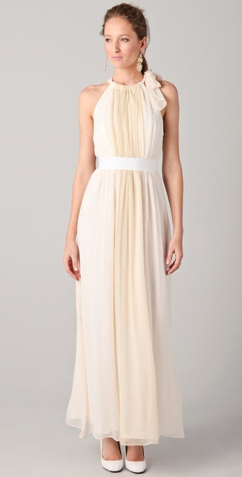 A perfect choice to beat the heat at a Summer wedding; this breezy silhouette is as pretty as it is functional.  Thread Eleanor Halter Gown With Grosgrain Belt ($730)