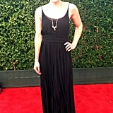Lindsay Miller wore a Rachel Zoe gown and a necklace by Heather Gardner to cover the Emmys red carpet.
