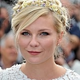 A fluffy, textured updo set off Kirsten Dunst's pretty embellished headband at the Cannes Film Festival.