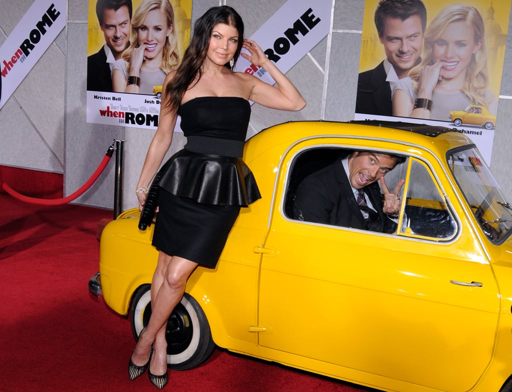 Fergie and Josh Duhamel played around on the red carpet at the LA premiere of When in Rome in January 2010.