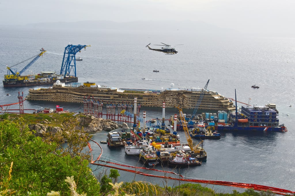 The upright ship was prepared to be towed away and scrapped.