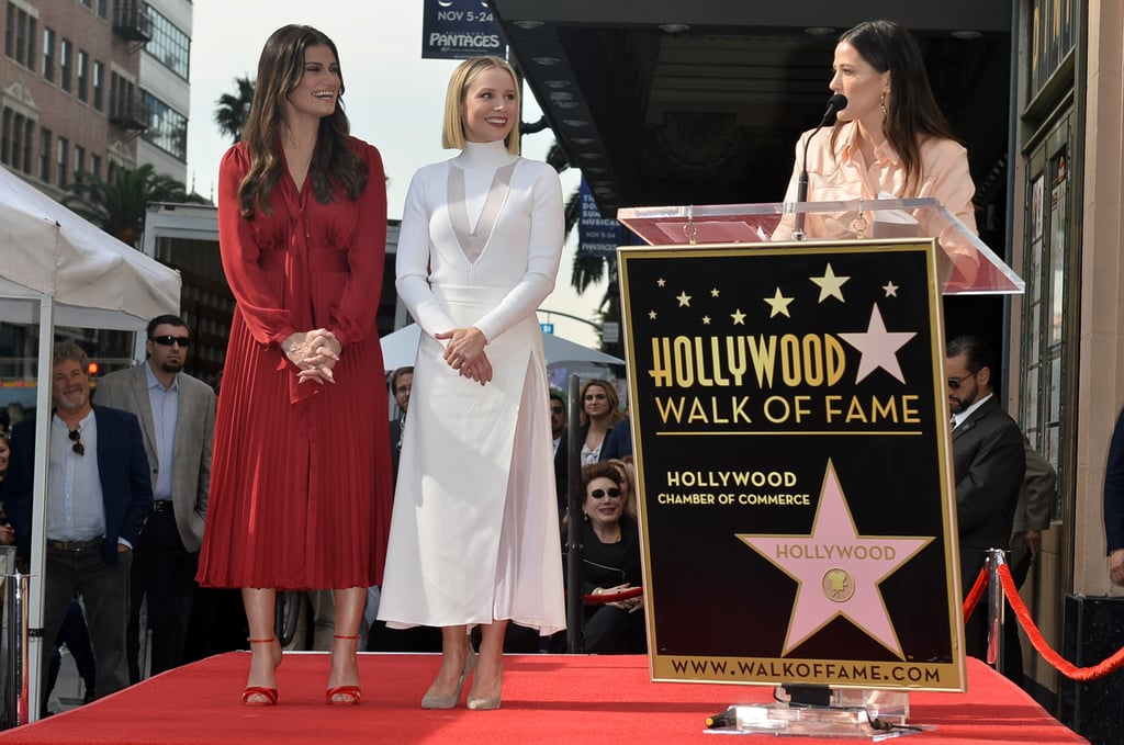 "Idina Menzel and Kristen Bell took a break from ruling Arendelle as they attended their joint Hollywood Walk of Fame ceremony on Tuesday. The Frozen costars, who play sisters Elsa and Anna in the Disney films, looked very festive as they supported each other for the big event. GLOW actress Jackie Tohn said a few words about her long-time friend Kristen, while their fellow Frozen costar Josh Gad brought the laughs during his funny speech about Idina.  Both Idina and Kristen have had incredible careers thus far. Idina is best known for her roles in Broadway's Rent and Wicked (the latter of which earned her a Tony), as well as her recurring role as Shelby Corcoran on Glee. Meanwhile, Kristen is best known for her roles on Veronica Mars and The Good Place, as well as countless comedy films like Forgetting Sarah Marshall and Bad Moms. See more photos from their joint appearance ahead.       Related:                                                                                                           Idina Menzel's Voice Will Blow You Away in New Song From Frozen 2, ""Into the Unknown"""
