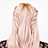 Repeat the rope braid on the other side of your head. There should be a section of your hair between both braids that hangs free, like in this image.