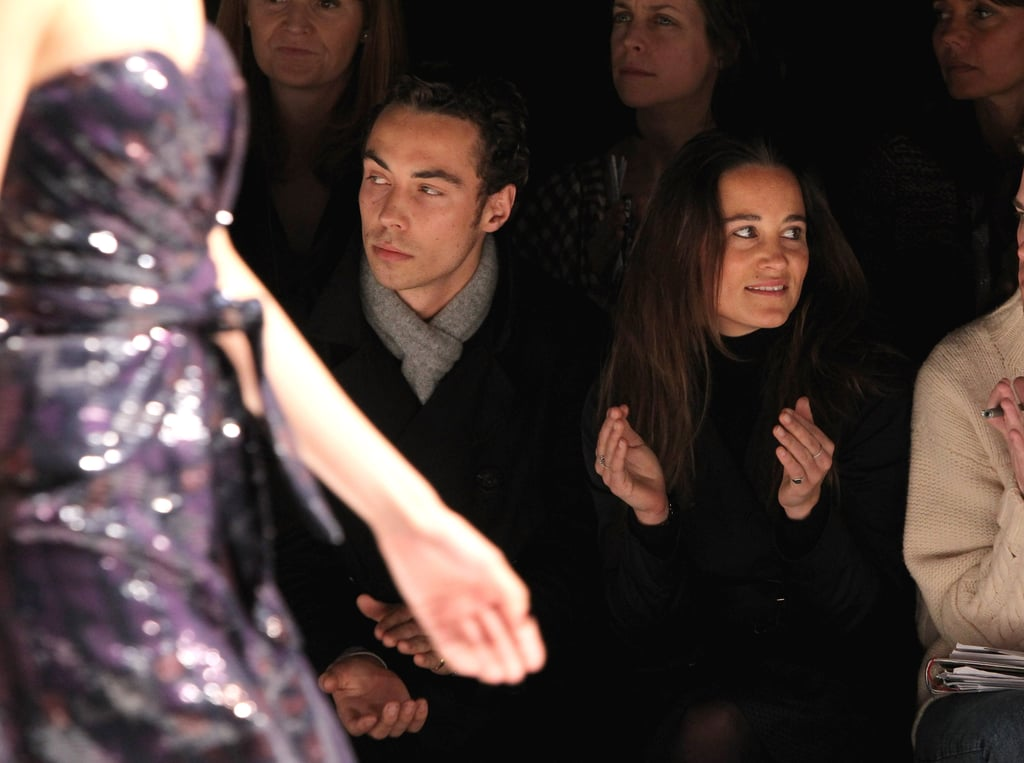 With her younger brother James at the Issa fashion show in 2010