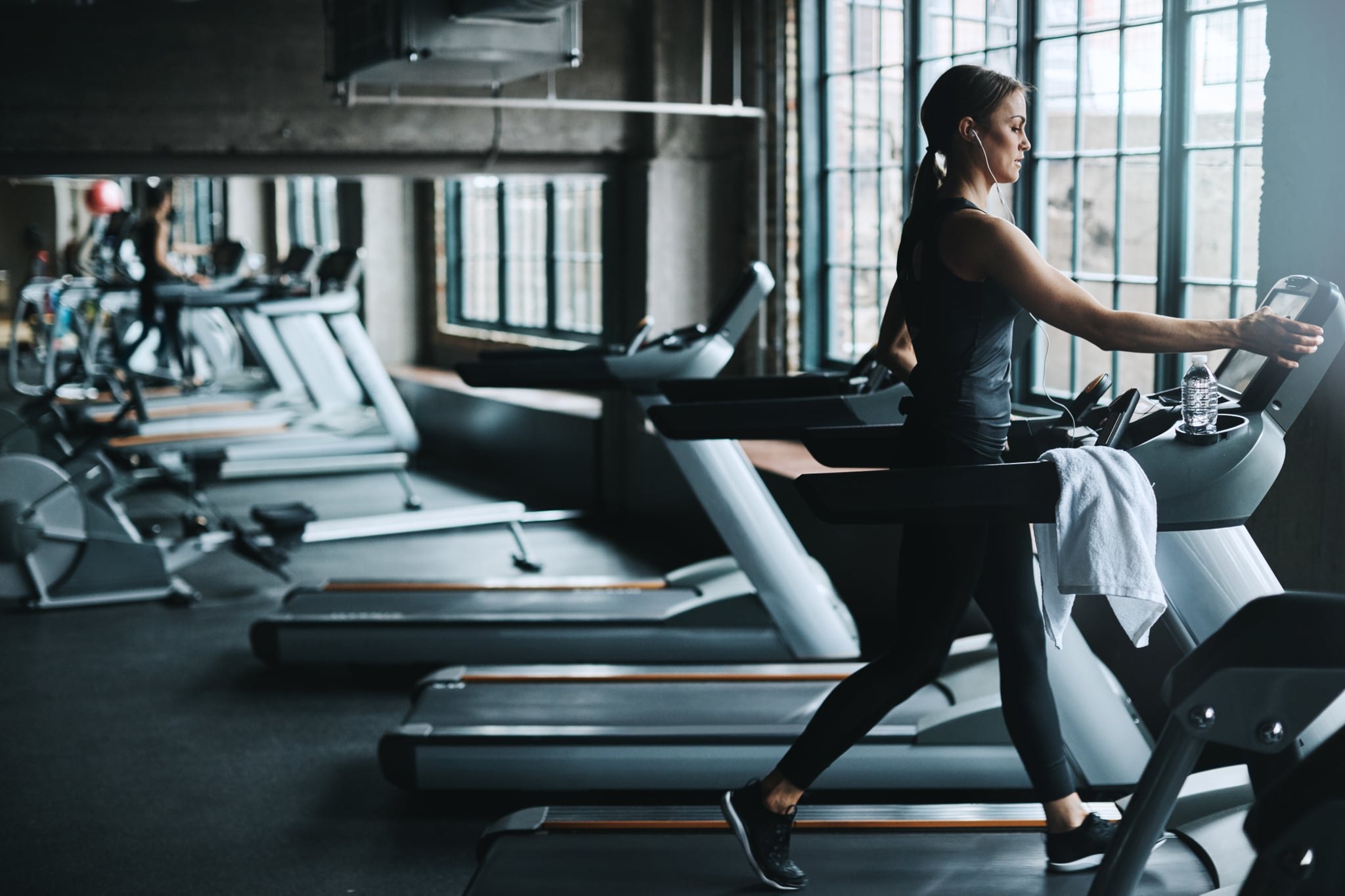 Shot of an attractive young woman working out on a treadmill in a gym