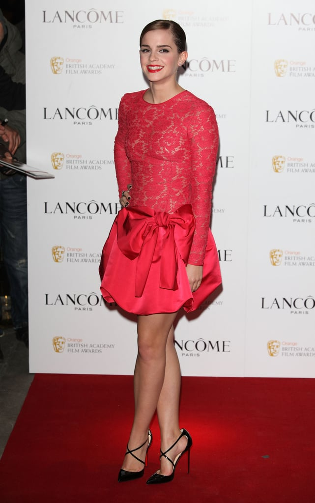 Emma Watson showed some skin in her lacy dress.