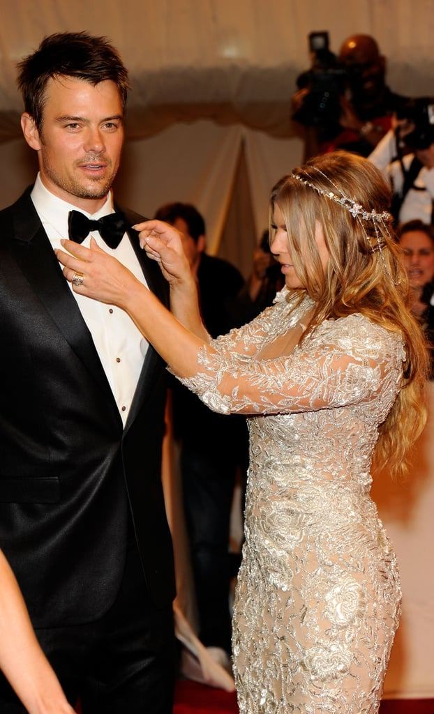 Fergie adjusted Josh Duhamel's tie at the Alexander McQueen Costume Institute Gala at the Metropolitan Museum of Art in NYC in May 2011.