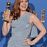 Amy Adams proudly showed off her statue in the press room.