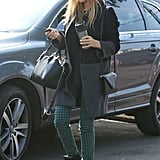 Jessica continued her reign as the print-jean queen, styling a pair of Big Star houndstooth denim with a colorblock coat and cutout leather duffel, both by Gérard Darel, and Isabel Marant sneakers in LA.