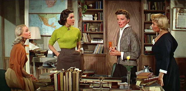 The 1957 film Desk Set stars Katharine Hepburn as the quick-witted head of a TV network's reference library, who along with her fellow female librarians must deal with an efficiency expert and his data computer that could threaten their jobs. The ladies are smart and feminine without falling into either the frumpy or sexed-up stereotypes.